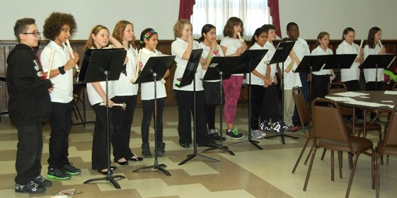 Arbelo students perform at luncheon for senior citizens.